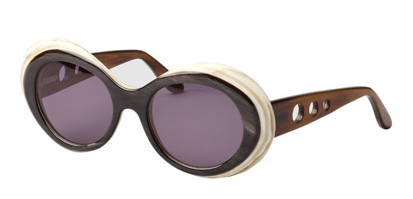 Gert::Morgenthal Frederics Buffalo Horn Collection.<br />Genuine buffalo horn, handcrafted in Germany. Laser-engraved cutouts on the temples makes this style even more sophisticated and unique.<br/>Brown on crème, with gray lenses.