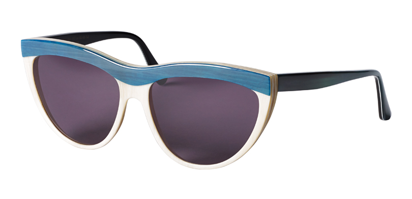 Kitt::Morgenthal Frederics Buffalo Horn Collection.<br />Genuine buffalo horn, handcrafted in Germany. Soft cat eye with unique colorations and three dimensional brow line.<br/>Teal brow line on white horn frame, with gray lenses.
