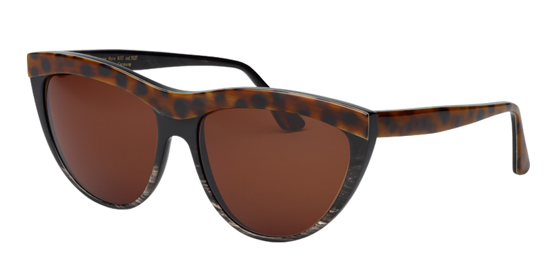 Kitt::Morgenthal Frederics Buffalo Horn Collection.<br />Genuine buffalo horn, handcrafted in Germany. Soft cat eye with unique colorations and three dimensional brow line.<br/>Spotty horn brow line on black frame, with brown lenses.